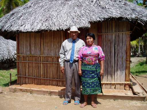 Feb '06 - Kuna Couple in Front of Kuna Home, Isla Pinos - click to enlarge
