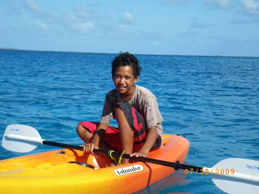 Jun '09 - One of the Samuela boys in a borrowed kayak - click to enlarge